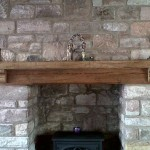 Oak Beam On Large Stone Fireplace